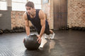 Man doing push ups on medicine ball Royalty Free Stock Photo