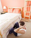Man Doing Sit-Ups in Bedroom Royalty Free Stock Photo