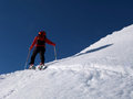 Man doing ski touring ascending hill Royalty Free Stock Images