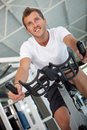 Man doing spinning at the gym Royalty Free Stock Images