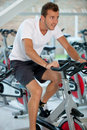 Man doing spinning at the gym Stock Images