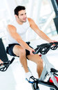 Man doing spinning at the gym Stock Photos
