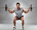 Man doing squats with barbell Royalty Free Stock Photo