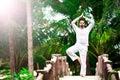 Man doing yoga in tropic jungle bridge Royalty Free Stock Photo