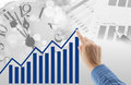 Man drawing graph growth of business duration with time clock and document background Royalty Free Stock Photo