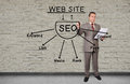 Man drawing seo scheme businessman on a invisible wall Stock Images