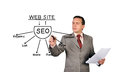 Man drawing seo scheme on a white background Royalty Free Stock Photo