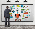 Man drawing startup sketch on whiteboard Royalty Free Stock Photo