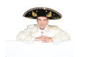 Man dressed as a mariachi with board left blank for your message Stock Photos