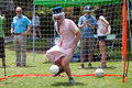 Man dressed as queen elizabeth plays soccer goalie at festival atlanta ga usa may a against kids the great a spring celebrating Stock Photography