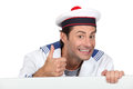 Man dressed in sailor costume with message board Stock Photography