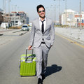 Man dressed in suit with a suitcase Stock Photography