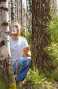 Man drink birch sap in the spring forest Royalty Free Stock Photography