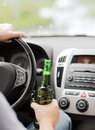 Man drinking alcohol while driving the car transportation and vehicle concept Royalty Free Stock Images