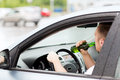 Man drinking alcohol while driving the car transportation and vehicle concept Stock Photography