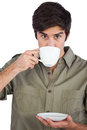 Man drinking cup of coffee on a white background Stock Images
