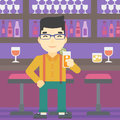 Man drinking orange cocktail at the bar. Royalty Free Stock Photo