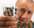 Man drinking pills Royalty Free Stock Photos
