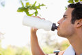 Man drinking from a sports bottle Stock Images