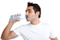 Man drinking water from bottle portrait of young isolated on white background Royalty Free Stock Photos