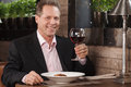 Man drinking wine. Portrait of cheerful businessman drinking Royalty Free Stock Photo