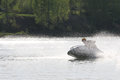 A man drive on high speed chase on the jet ski lake in leningrad region russia Stock Images