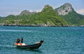 Man driving longtail boat at ang thong national marine park thailand in Stock Image