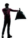 Man dumping smelly garbage bag in silhouettes on white background Stock Photos