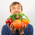 Man eat green stuff and hold in his hand fresh vegetables and fruits Royalty Free Stock Image