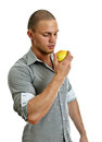 Man eating an apple. Royalty Free Stock Photography