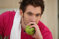 Man eating an apple about to eat Royalty Free Stock Images