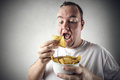 Man eating chips Royalty Free Stock Photo