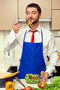 Man eating fresh salad Royalty Free Stock Images