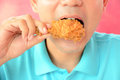 A man eating fried chicken leg or drumstick Royalty Free Stock Photo
