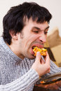 Man eating junk food Royalty Free Stock Photos
