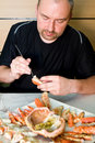 Man eating king crab Royalty Free Stock Image