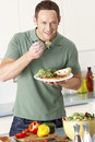 Man Eating Meal In Kitchen Royalty Free Stock Photo