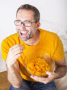 Man eating potato chips Royalty Free Stock Photo