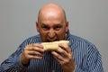 Man eating potato chips hurriedly Royalty Free Stock Photo