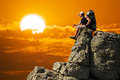 Man on edge of mountain traveling life Stock Photo