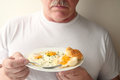 Man with eggs and biscuit breakfast Royalty Free Stock Photo