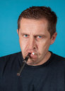Man with electric and ordinary cigarette adult Royalty Free Stock Image