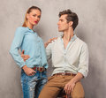 Man embracing his girlfriend while she rests one hand on his sho Royalty Free Stock Photo