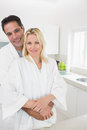 Man embracing woman from behind in kitchen portrait of a men women the at home Royalty Free Stock Image