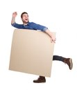 Man with empty poster sign full length portrait of a handsome young smiling Stock Photo