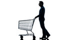 Man with empty shopping cart silhouette Royalty Free Stock Photo