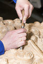 Man engaged in woodcarving wood Stock Image