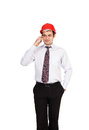 Man engineer in a red helmet talking on the phone this image has attached release Stock Photography