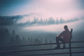 Man enjoy misty valley. Instagram stylization Royalty Free Stock Photo