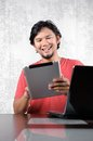 Man enjoy the tablet asian Stock Images